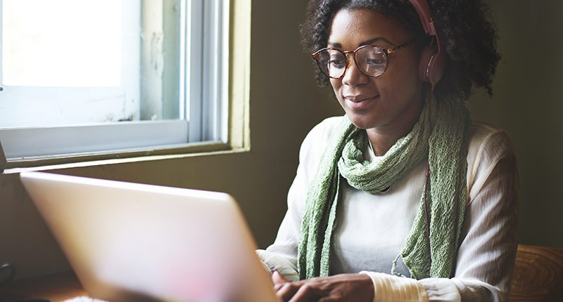 Black casual woman working on the computer